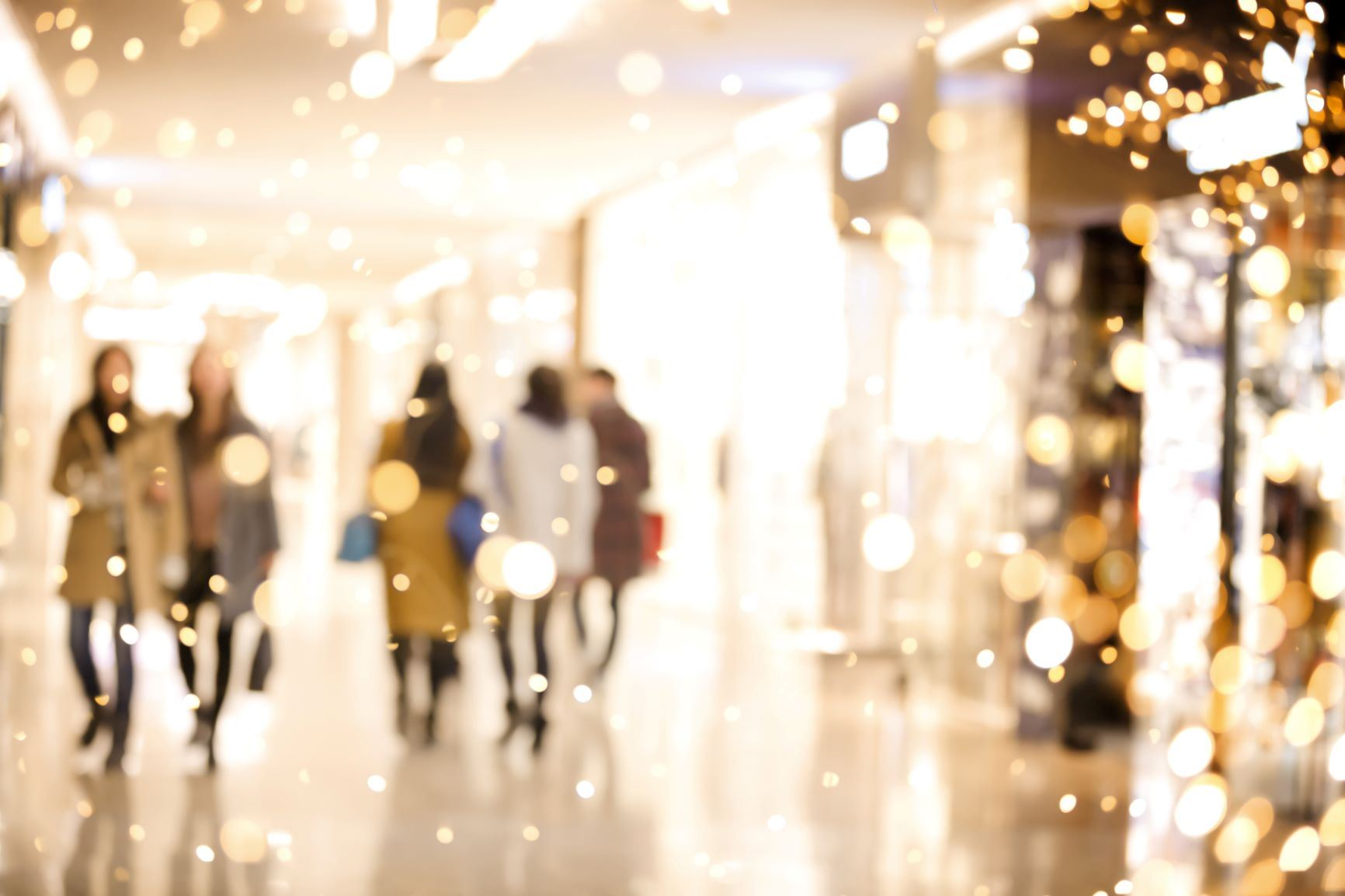 iStock Holiday shoppers in blurred holiday lights)